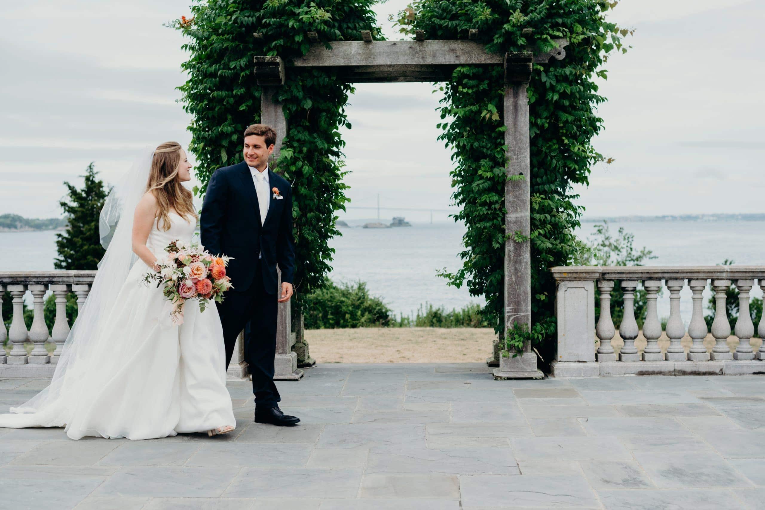 bride and groom walking at castle hill inn Rhode Island