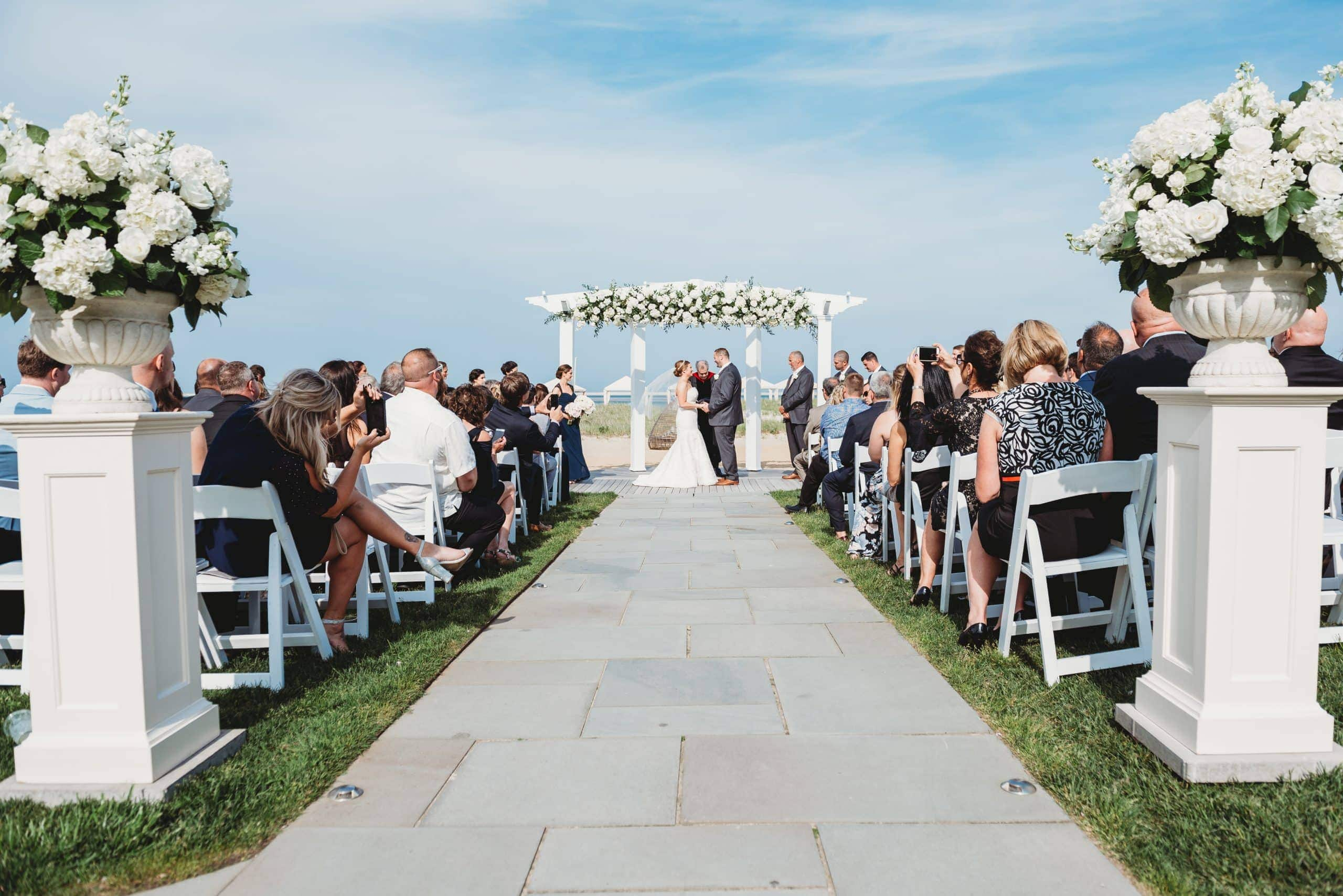 bride and groom end of aisle chatham bars inn waterfront wedding venues