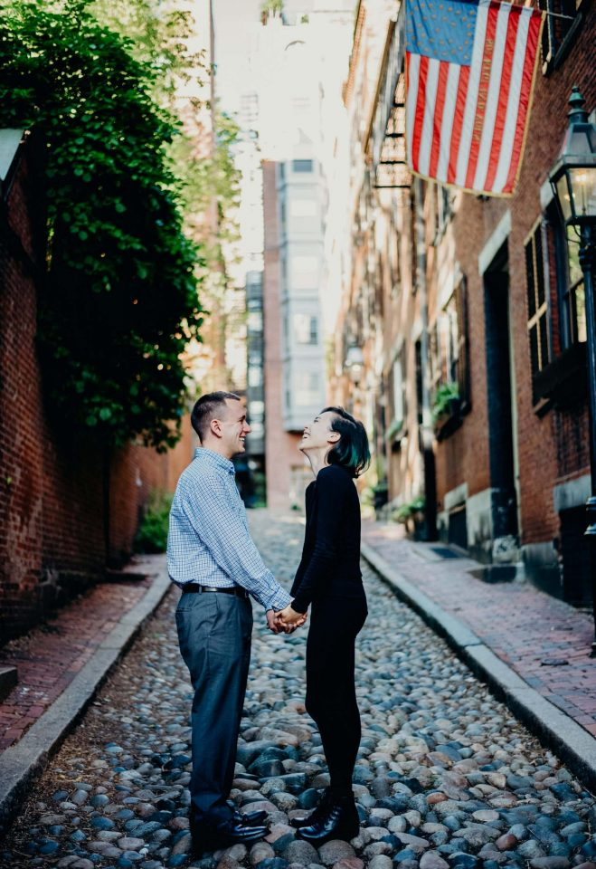 engaged couple holding hands laughing acorn street beacon hill Boston