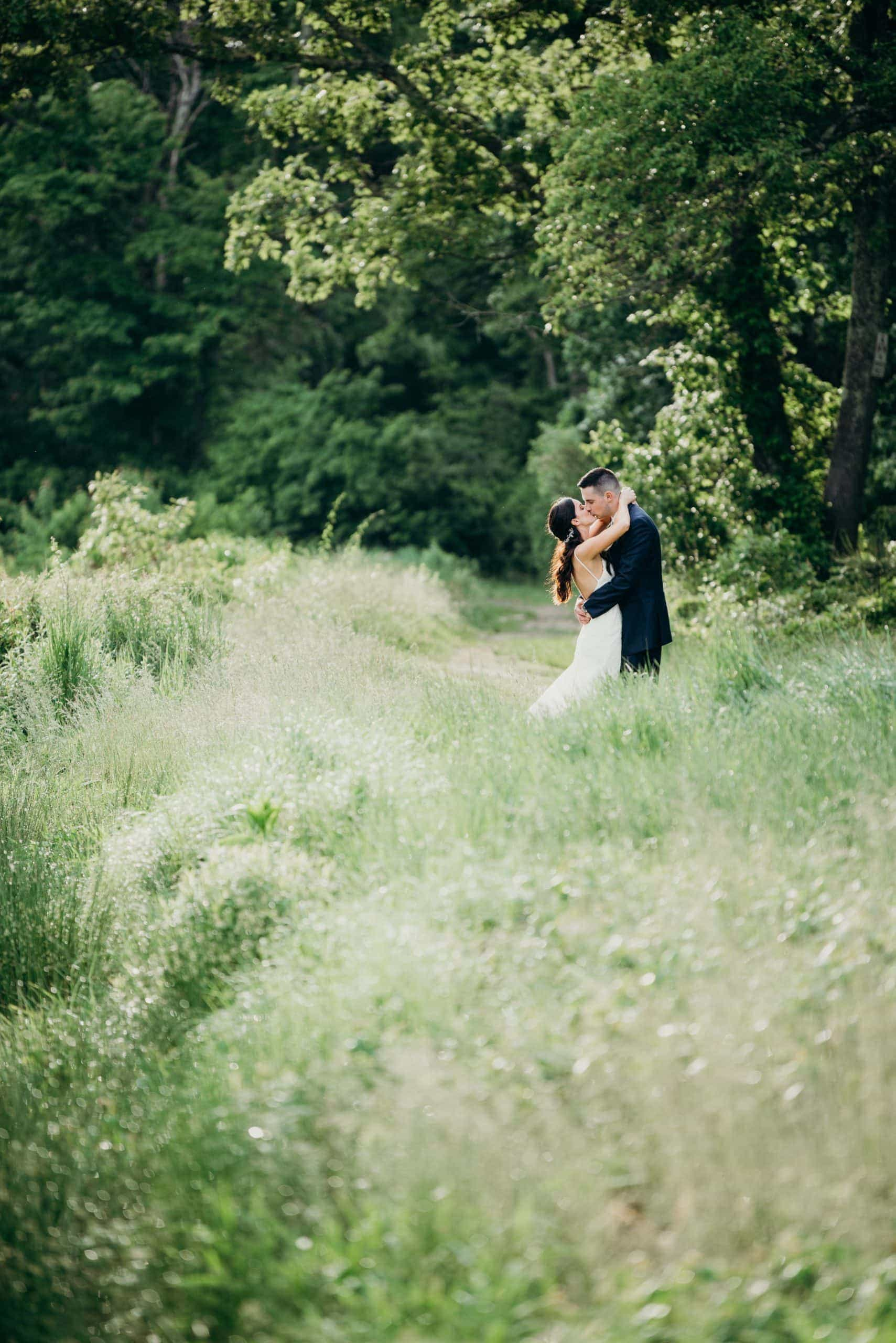 wedding couple kissing in field camp kiwanee hanson Massachusetts