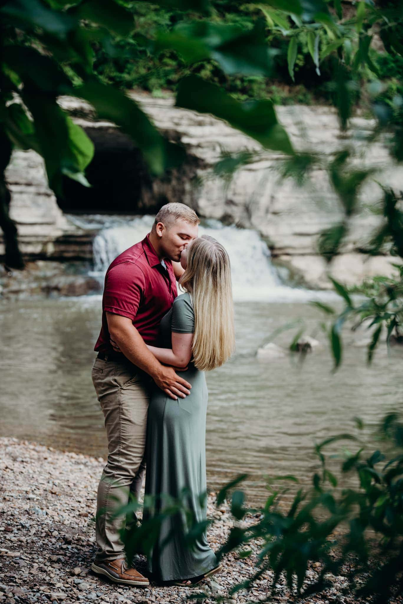guy kissing fiancé at their waterfall engagement session at narrows of the harpeth in tennessee