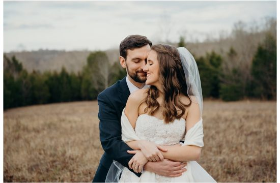 couple's heads touching during formal wedding portraits in a field at Firefly Lane Dickson TN
