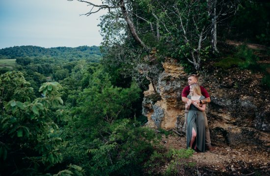 couple on cliff edge at their narrows of the harpeth engagement session