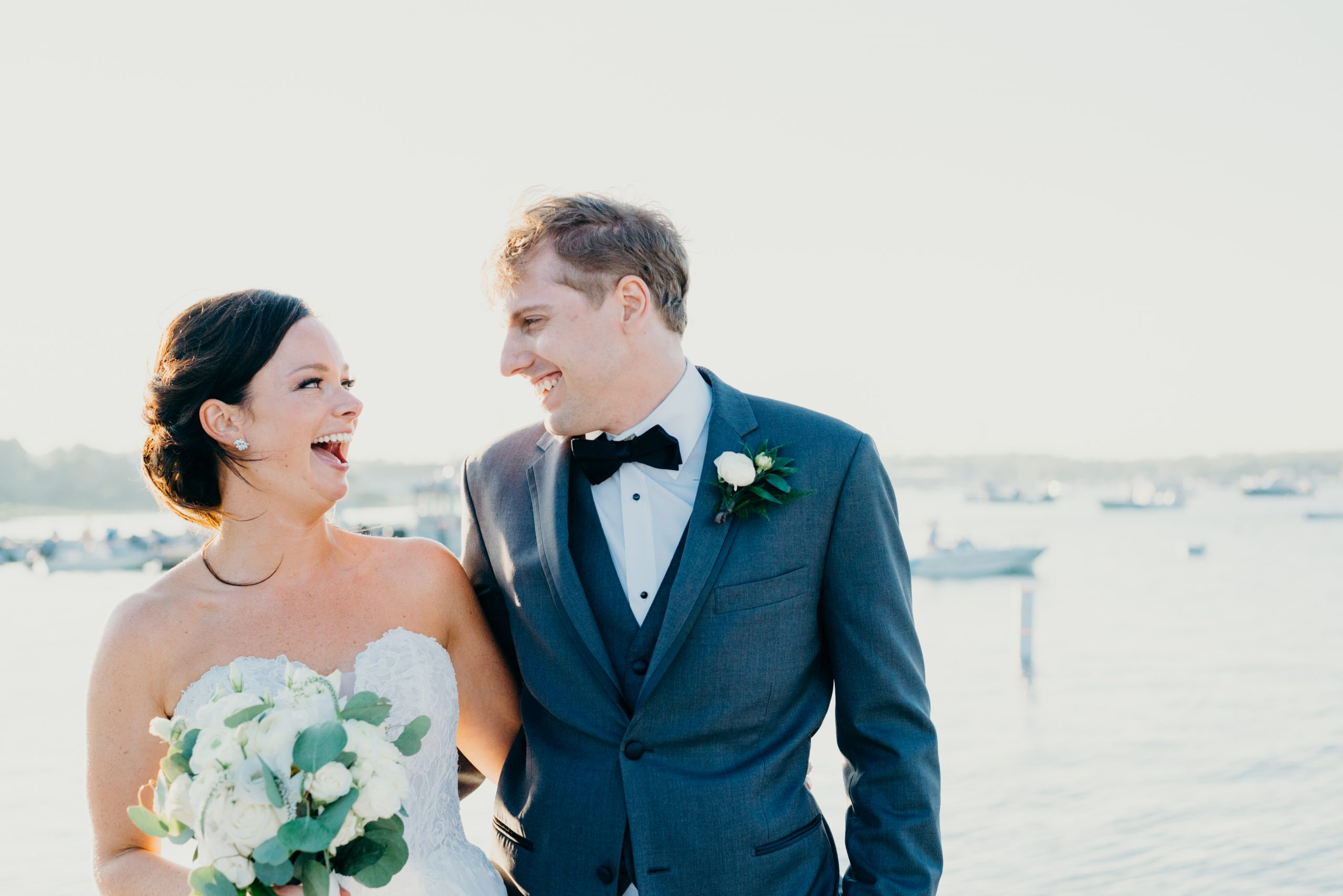 couples laughing on dock during their cape cod elopement