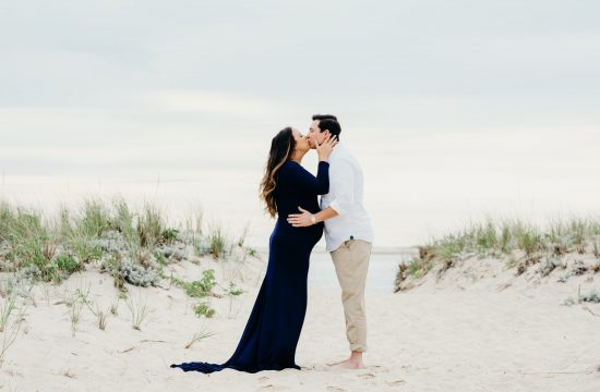 couple kissing during their chatham cape cod maternity session